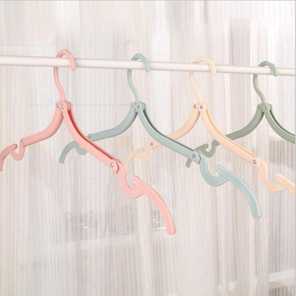 5 pcs/lot new household helper candy foldable plastic coat magic hanger easy portable travel hangers for clothes saving space free shipping