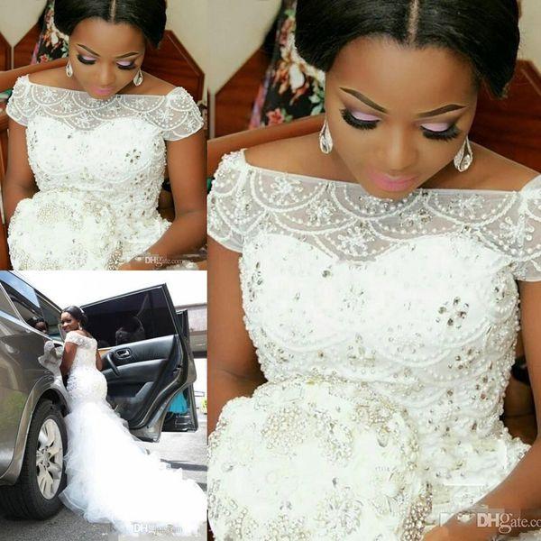 top popular Charming Plus Size Arabic Nigerian Mermaid Wedding Dresses Beading Cap Sleeve Tulle Ruffles Mermaid Bridal Gowns 2019