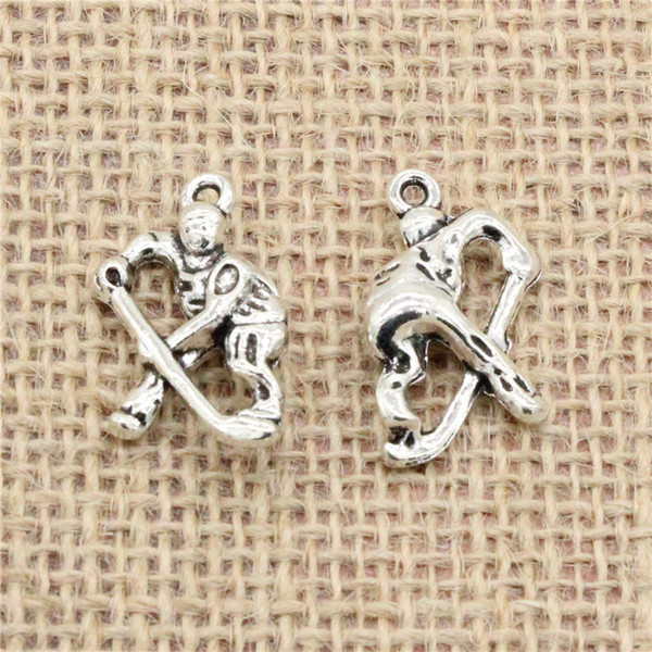 Wholesale 45pcs Charms Tibetan Silver plated hockey player sporter 26*16mm Pendant for Jewelry DIY Hand Made Fitting