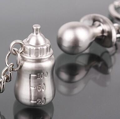 Wholesale- 1pairs Portachiavi placcato argento Bottiglia di latte Capezzolo Portachiavi baby shower regalo di nozze portachiavi gioielli fascino favore
