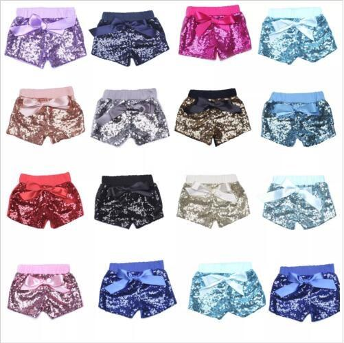 top popular Baby Sequins Shorts Summer Glitter Pants Girls Bling Dance Party Shorts Sequins Costume Glow Bowknot Trousers Fashion Boutique Shorts B2250 2020