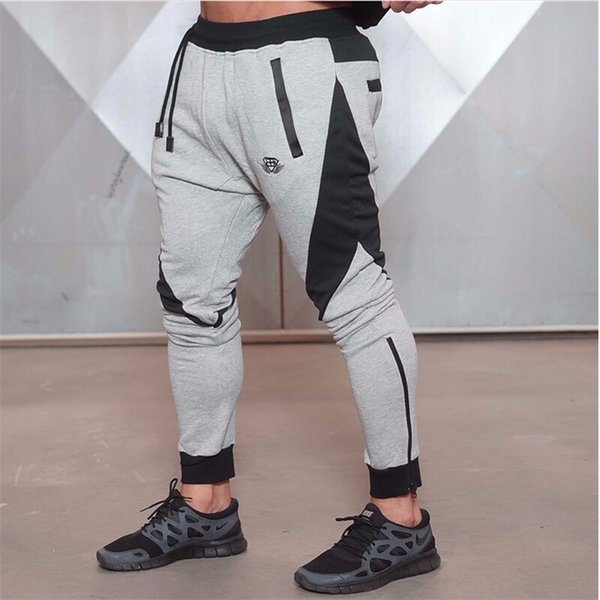 top popular New Gold Medal Sports Fitness Pants Stretch Cotton Men's Fitness Jogging Pants Body Engineers Jogger Outdoor 2019