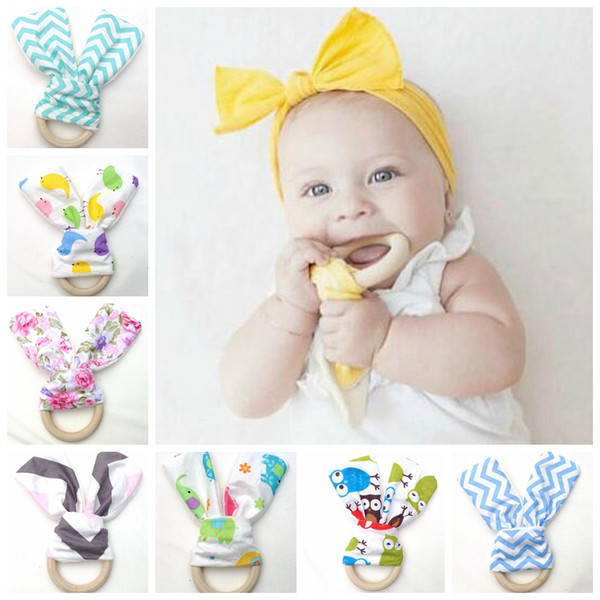 top popular 50pcs Infant baby Teethers Teething Ring teeth Fabric and Wooden Teething training Crinkle Material Sensory Toy Natural teether YE001 2020