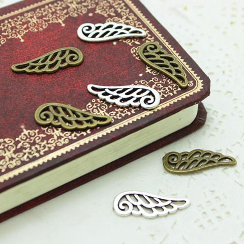 top popular Sweet Bell 9*24mm two color Metal Alloy Hollow Angel Wings Jewelry Making Charms D0256 2019
