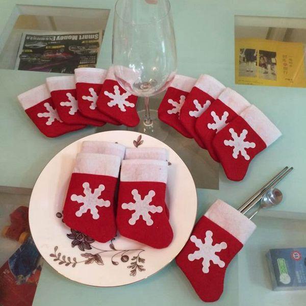 Al por mayor- 12pcs / lot decoración de la mesa de Navidad cubiertos Holdersanta bolsillos cuchillo de la cena tenedor tenedor adornos de navidad santa claus
