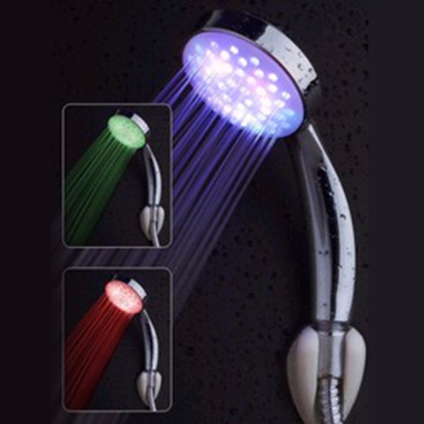 top popular Romantic Automatic 7 Color LED Lights Handing Shower Head for Bathroom 2021