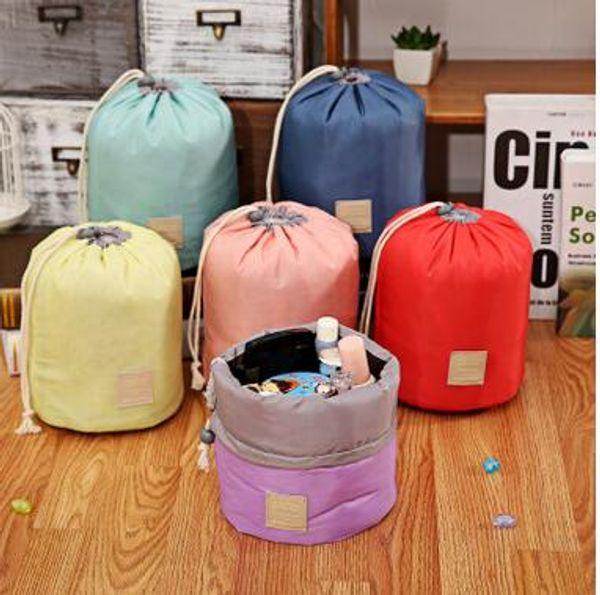 top popular New Arrival Barrel Shaped Travel Cosmetic Bag Nylon Polyester High Capacity Drawstring Elegant Drum Wash Bags Makeup Organizer Storage Bags 2021