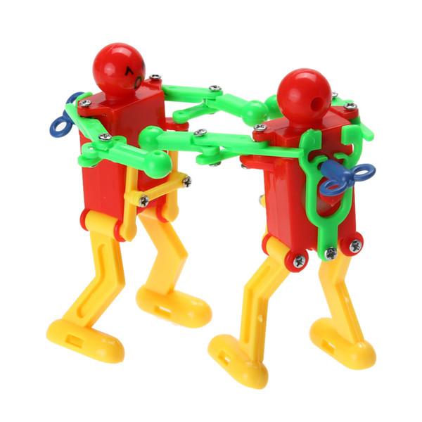 5 Adet / grup Clockwork Bahar Rüzgar Kadar Oyuncak Dans Robot Oyuncak Çocuk Çocuklar için Oyuncak Sarı Yeşil Kırmızı Rastgele Renk