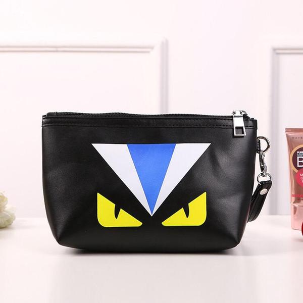 Cartoon small monster large capacity cute makeup cosmetic bag/monster pattern black wash bag/clutch bag