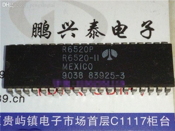 R6520P / R6520-11 . Peripheral Interface IC , dual in-line 40 pin package . Electronic Components / PDIP40 / IC