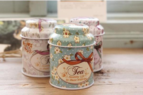 200 adet / grup Vintage stil baskı çiçek serisi metal çay kutusu Sevimli teneke kutu Yuvarlak ev saklama kutusu Demir şeker konteyner Hediye