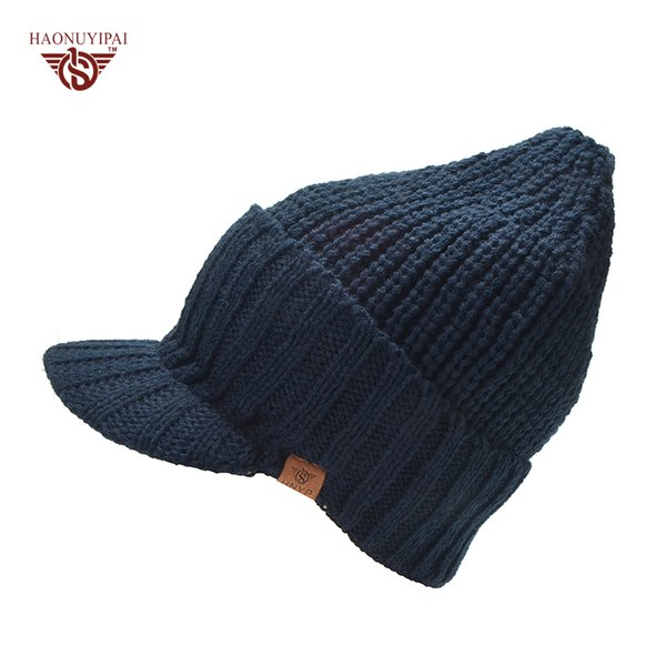 Men  S Autumn And Winter Warm Wool Knitted Hats With Visor Brand Hnyp Brim  Outside Ear Protection Knit Skiing Beanies Cap 2017 a378c126832a