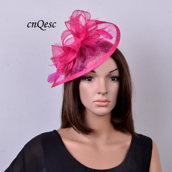 Hot pink/fuchsia Sinamay fascinator hat with feathers for wedding,party,kentucky derby,melbourne cup,races.