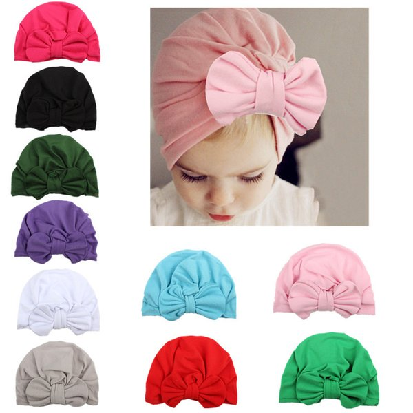 Mezcle 10 colores Bebé conejo oreja cabeza anudada sombrero Niños bowknot Turbante Casquillos suaves Infant Toddler Fashion Beanies Winnter sombreros al por mayor
