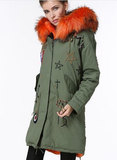 Marchio Meifeng Arancione pelliccia di procione trim Francia Bandiera bordare cappotto arancione pelliccia di coniglio fodera verde militare tela lunga parka donna giacche da neve