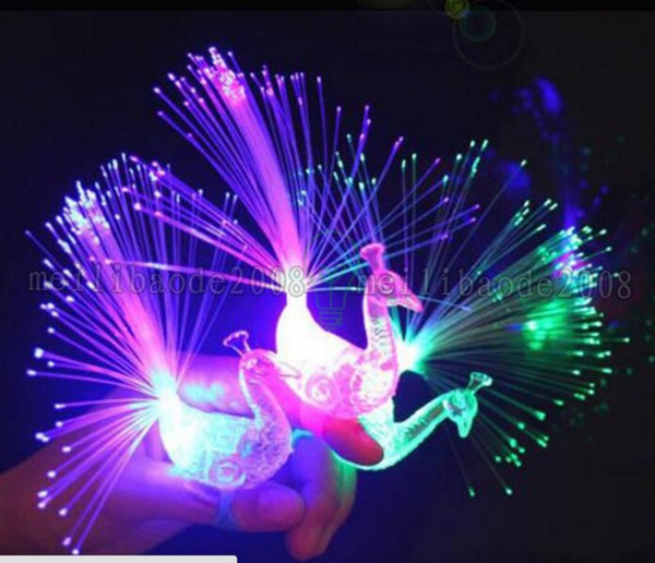 top popular 2017 NEW Novelty Design Colorful Light Peacock LED Light-up Finger Toys Best Christmas Halloween Party Gifts MYY 2019