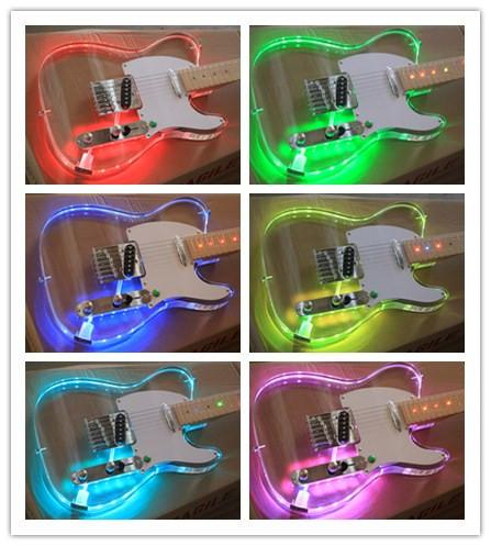 best selling Wholesale- Factory acrylic body electric guitar with white pickguard,chrome hardware,the light color can be adjusted by the green switch