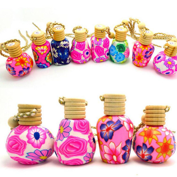 top popular New Arrive Car hang decoration Ceramic essence oil Perfume bottle Hang rope empty bottle free shipping 2021