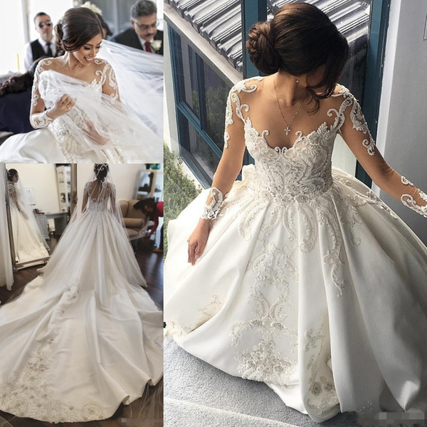 2017 New Luxury Wedding Dresses A Line Jewel Neck Illusion Long Sleeves Lace Appliques Beaded Cathedral Train Plus Size Formal Bridal Gowns