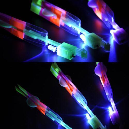 USA-ePacket 50PCS LED Light Flying Sling Helicóptero Rocket Arrow Frisbee Flyer Boomerang Toys