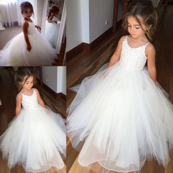 top popular Cheap Spaghetti Lace And Tulle Flower Girl Dresses For Wedding White Ball Gown Princess Girls Pageant Gowns Children Communion Dress 2019