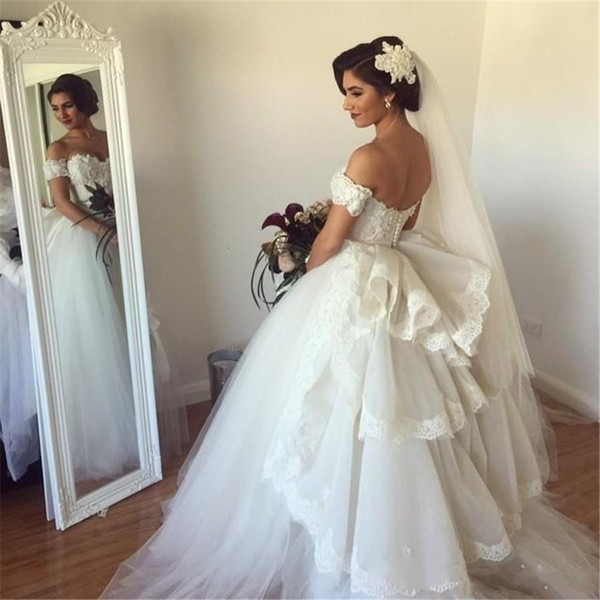Off The Shoulder Wedding Dresses Lace Appliques Short Sleeves Peplum Covered Button Bridal Gown Charming A-Line Puffy Tulle Wedding Gowns