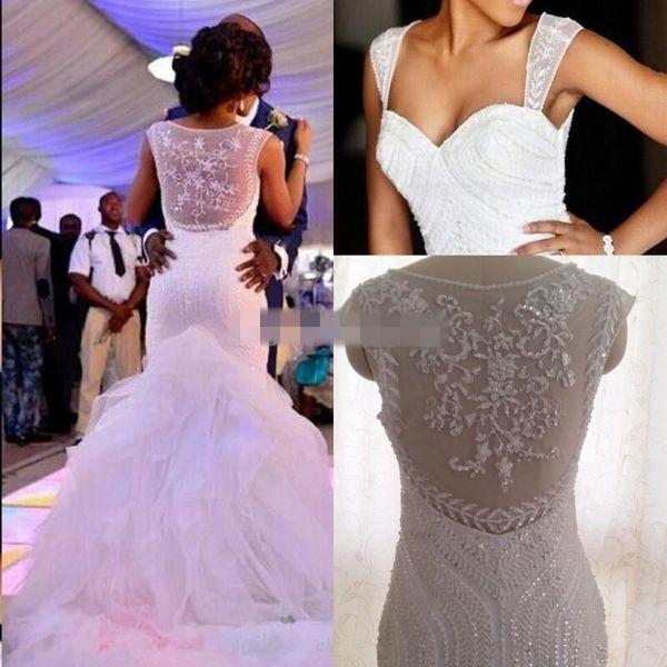 top popular African Style Plus Size Mermaid Wedding Dresses 2020 Cap Sleeves Beaded Crystal Ruffled Tulle Puffy Wedding Gowns Vestidos De Noiva 2020