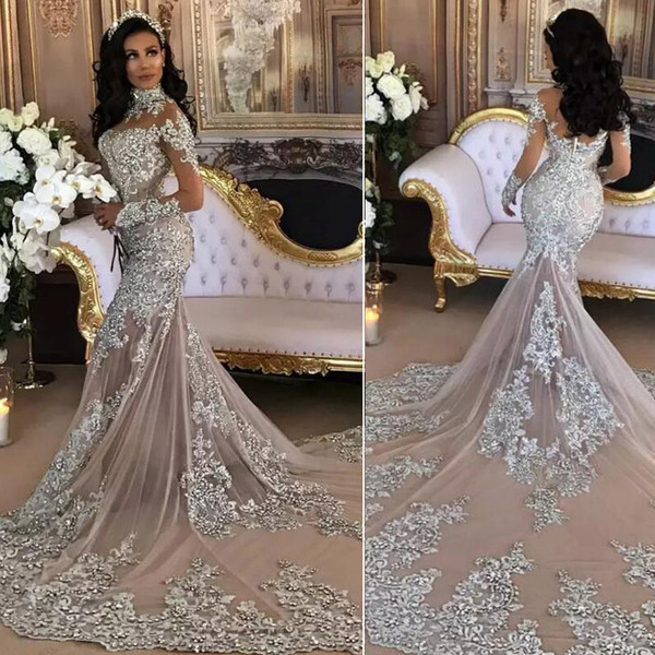 top popular Sexy Silver Mermaid Wedding Dresses High Neck Long Sleeves Applique Sequins Beaded Illusion Sparkly Saudi Arabic Bridal Gown Real Image 2019