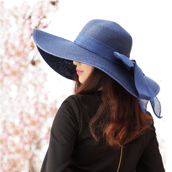 Wholesale- MASCOTT The 2016 summer paper straw hat Navy wide brim bowknot steamer breathable sun hat Women holiday beach when Yang cap