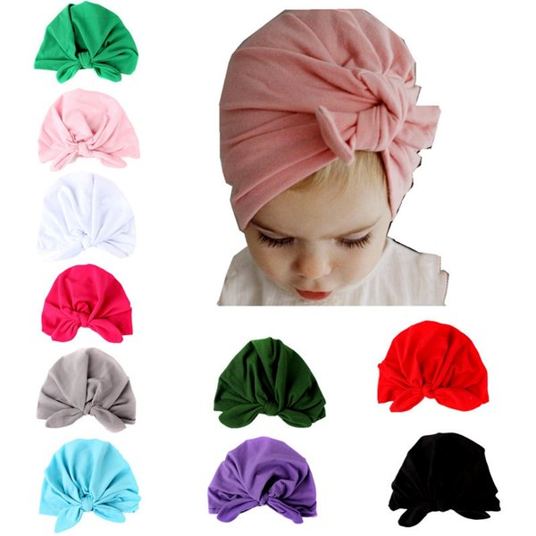 top popular INS Baby Bow Hat Bunny Ear Caps Europe Style Turban Knot Head Wraps Hats 10Colors Infant India Hats Kids Winter Beanie 2019