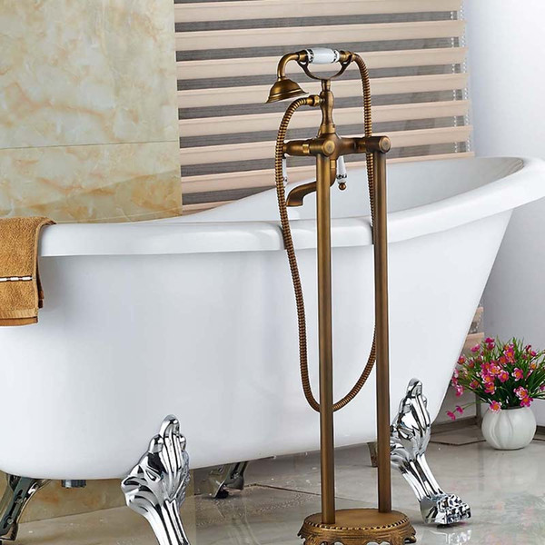 top popular Luxury Antique Brass Floor Mounted Bathroom Tub Faucet Dual Handles with Hand Shower Sprayer Tub Filler Mixer Tap 2021