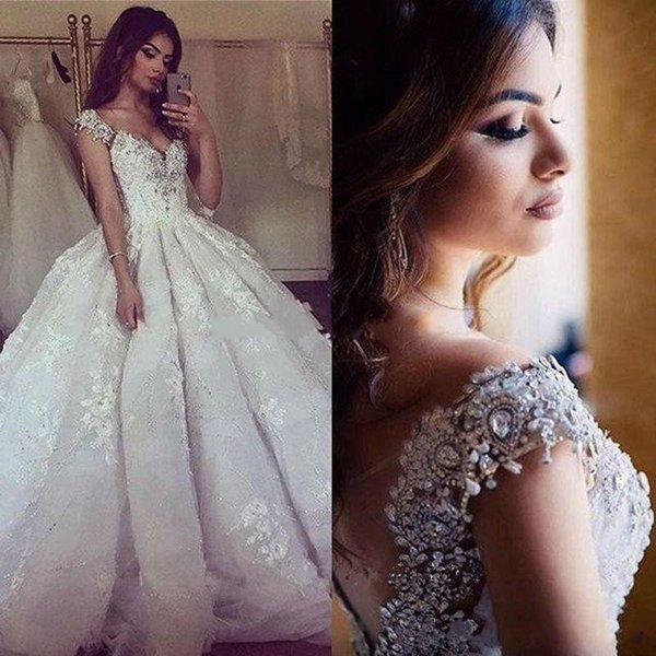 2017 Arabic Dubai Bling Ball Gown Wedding Dresses V Neck Cap Sleeves Lace Applique Beads Crystal Sequins Puffy Cathedral Train Bridal Gowns