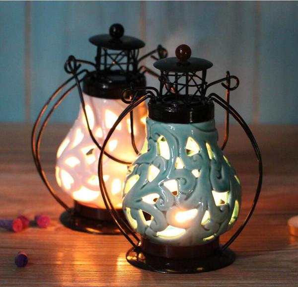 Cinese vento hollow candeliere di ceramica piuma di ferro candelabro candela di nozze marocchine lanterne di natale ornamento di nozze decorazioni per la casa