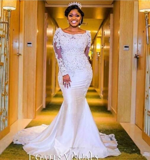 f80075cd07a1 2018 Nigerian Mermaid Wedding Dresses Sweetheart Beaded Lace Appliqued Long  Sleeves Chapel Train Length African Black