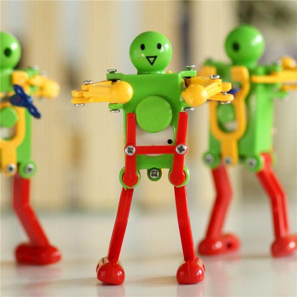 top popular Robots Toys Clockwork Spring Wind Up Toy Dancing Robot Baby Toys for Children Kids Toy Random Color Brinquedos 2021
