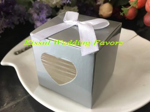 White bow on silver box