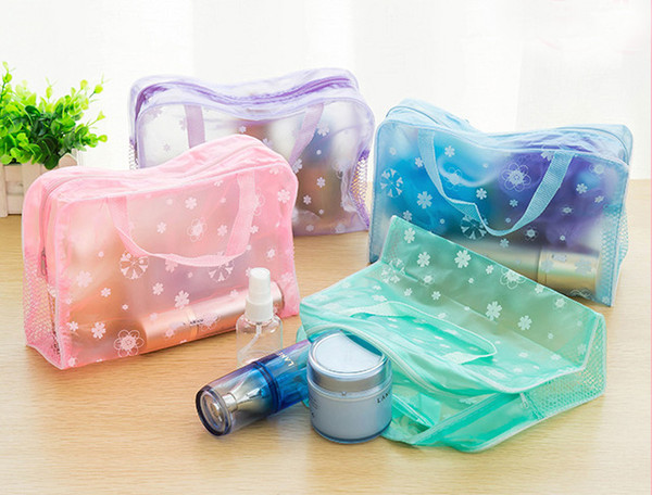 top popular Wholesale ChinaMakeup Bags Cosmetic Bags Transparent Waterproof PVC Bag Floral Print For Toilet Bathing Pouch Travel free shipping E004 2021