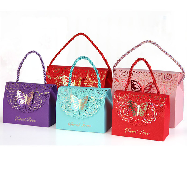 Candy packaging boxes with handle Lovely small paper bags 3D butterfly emboss Paper boxes for wedding gift sweets hollow out design