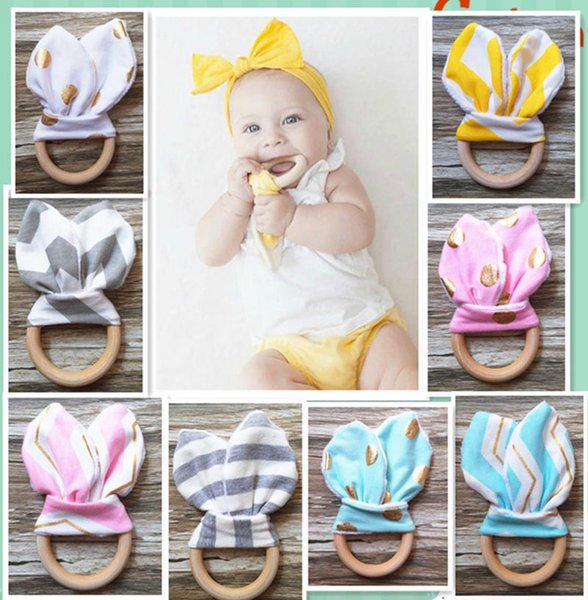 top popular 28 Colors Baby INS Teethers Natural Wood Circle With Rabbit Ear Fabric Newborn Teeth Practice Toy Training Handmade Ring B001 2020