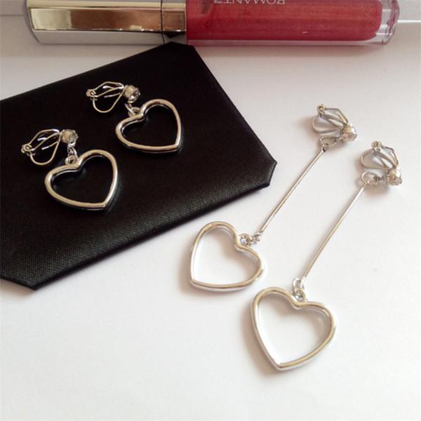 best selling XS No Ear Hole Hollow Out Lovely Peach Heart Clip On Earrings For Women Geometry Alloy Material Eardrop TJ026