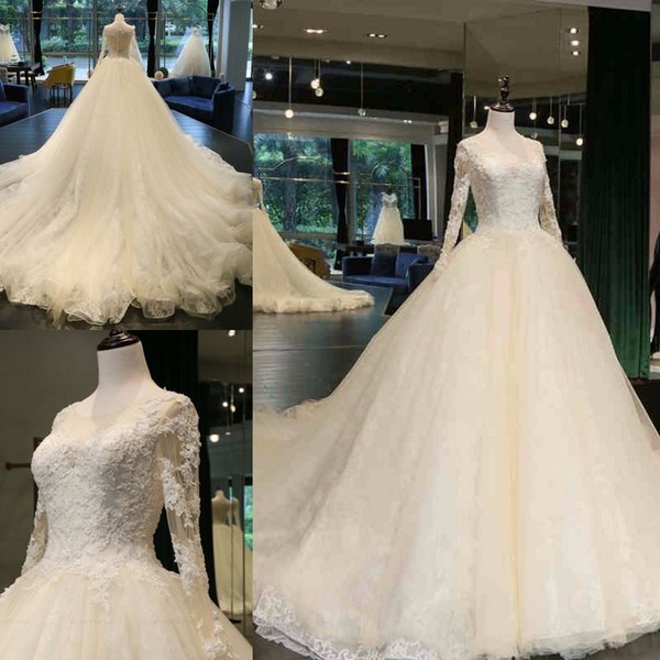 0cc86f6cfe 2018 Newest Jewel Neck A-line Wedding Dresses Cathedral Train Appliques Beaded  Long Sleeve Button up Back Bridal Wedding Gowns