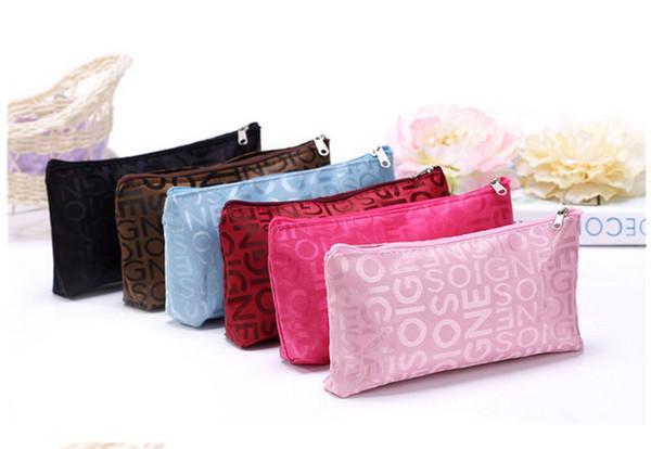 top popular Wholesale Women Makeup Bag Hot New Designer Letter Storage Bag Fashion Cosmetic Bag Travel Waterproof Wash Bags By DHL 2021