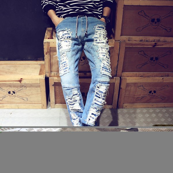 Wholesale-2016 New Arrival Famous Brand Ripped Jeans Men High Quality Rivet Ripped Jeans for Men Casual Style Hole Pencil Pants Hot Sale