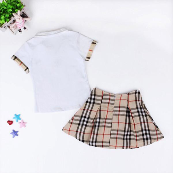 Yüksek kalite kızlar t shirt + ekose etek seti bebek pamuk giyim çocuk gömlek üstleri giyim setleri çocuklar bebek giysileri klasik tarzı sıcak