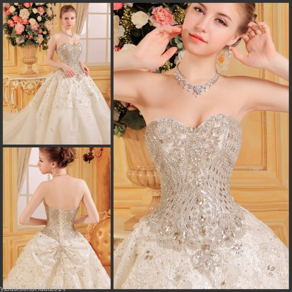 Bling Sweetheart Luxury Wedding Dresses Beaded Swarovski Crystal Sexy Ball Gown Lace Applique Court Train Tulle Diamond Bridal Gown With Bow