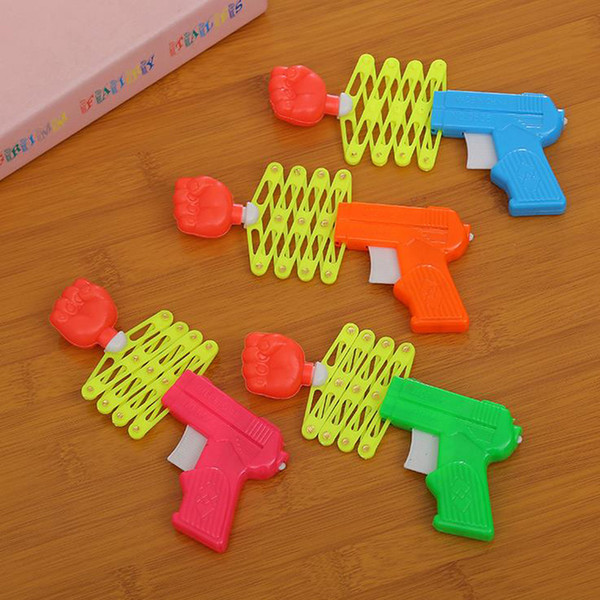 2017 new Children's toys creative retractable fist-gun mini-funny elastic gun spring magic gun small toy free shipping