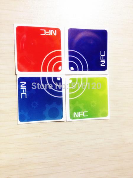 Venta al por mayor (4 PC / lote) Etiquetas NFC Etiquetas Ntag216 13.56mhz Etiqueta RFID Tarjeta inteligente para Samsung galaxy S5 Note3 Sony Xperia Nokia Nexus7 LG HTC