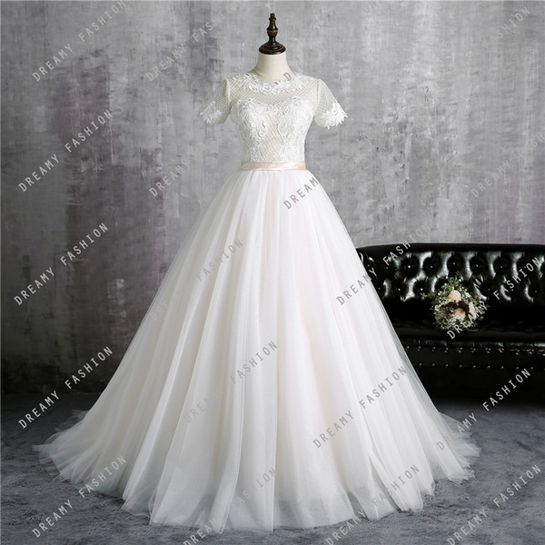 2018 Cheap Ball Gown Wedding Dresses Jewel Neck Illusion Short Sleeves Lace Appliques Sashes Beach Country Floor Length Bridal Gowns Custom