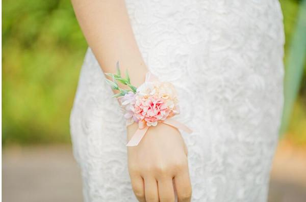 pink wrist flowers