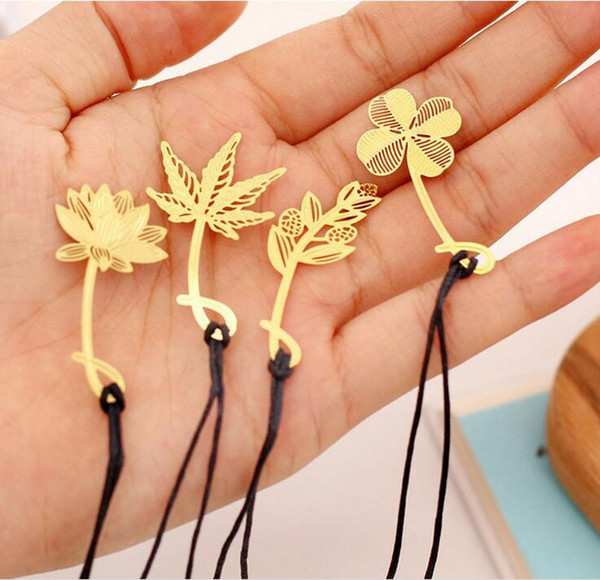 top popular Vintage Exquisite Plant Cutout Blade Metal Bookmark Openwork Bookmarks For Books Kids Paper Clips Stationary Office School Supplies ZA1456 2021
